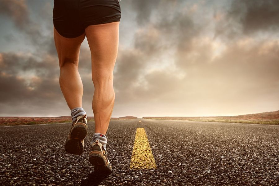 Man jogging on a road because cardio is really beneficial for CKD